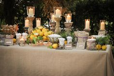 I love the lemons, and the candles.  The simple burlap is also an easy go to for linens.