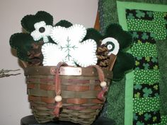 A green Longeberger Bee basket displays a few of the felt shamrocks I made for St. Patrick's Day.