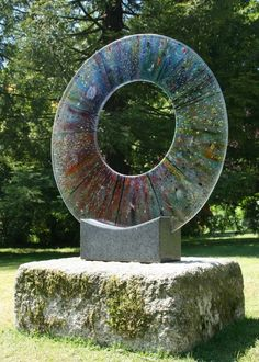 Fused glass Abstract Contemporary or Modern Outdoor Outside Exterior Garden / Yard Sculptures Statues statuary sculpture by artist Arabella Marshall titled: 'Infusion (Glass Circular Outdoor garden Focal Point statue)'