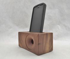 This is an acoustic SpeakerBlock that works with all versions of the iPhone 4, 5, and 6 including the 6 plus. It is all wood and made of Walnut. It