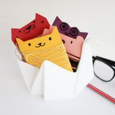 Keep your ribbons and string clean and tidy with a set of these adorable animal thread organizers
