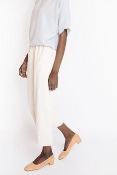 Rashida Pants from Hackwith Design House in cream denim. These pants features a wide leg, raw hem edge, elastic waist and a soft washed denim feel with side pockets. These pull-on pants pair great wit