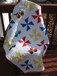 "Quilt for grandson.  Applique cars from pattern ""Peak Hour"" - fun idea: classic blocks alternating with applique"
