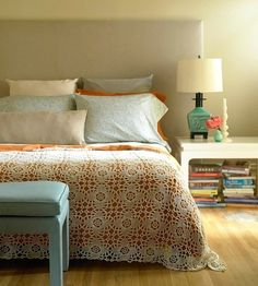 {crocheted blanket, shades of blue, headboard, stacks of books}
