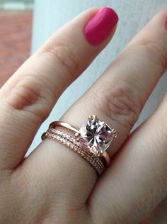 8.5mm barely pink cushion moissanite (harder than morganite( with 1.5mm light pink diamonds bands in 14K rose gold from Schubach's. engagement ring
