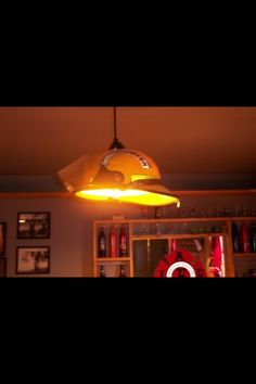 #Fire helmet turned into a kitchen light. Another way of reuse and recycling old #firedepartment gear and equipment. #DIY