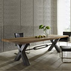 Distressed wood  metal leg dining table. Industrial modern design from Amode.