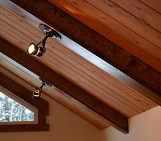 Exposed Beams With Suspended Wire Lighting Renovations