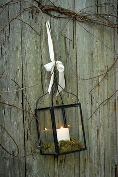 Easy Christmas outdoor decor, lantern tied with a simple ribbon.