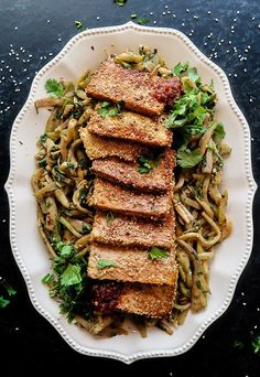 This Vegan Sesame Tofu and Eggplant recipe makes a wonderful light lunch, and is surprisingly vegan. The eggplant is julienned then tossed with a spicy Asian style marinade before its cooked down into soft noodles. The tofu slices are crusted with sesame Keto Vegan, Vegan Keto Recipes, Vegetarian Keto, Tofu Recipes, Diet Recipes, Healthy Recipes, Diet Desserts, Vegetarian Breakfast, Keto Foods