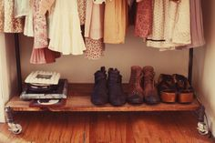 This rolling rack is practical and cute - it has room for your shoes!
