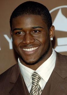 "Reginald Alfred ""Reggie"" Bush, Jr. (born March 2, 1985) American Football Running Back for Detroit Lions, National Football League (NFL). Played college football for University of Southern California (USC), Twice earned All-American honors, & recognized as Top College Running Back. New Orleans Saints chose him w/ second overall pick of 2006 NFL Draft. Bush won a Super Bowl title w/ Saints in 2010.  http://www.essence.com/2010/07/25/reggie-bush/"