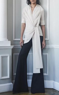 This **Hensely** top features a shortsleeved silhouette and a tie detail at the waist.