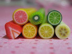 KITCHEN: Polymer clay canes fruit 7pcs for miniature foods decoden and nail art supplies lemon lime orange pink grapefruit banana kiwi strawberry. $6.00, via Etsy.