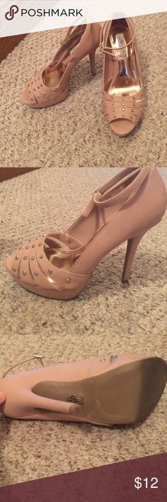 Jennifer Lopez heels These shoes are very cute. Too big for me size 8 but they fit me a little bigger than other size 8 shoes I have. The color is a pinkish tan with gold on the front. These have only been worn maybe once . Can be worn with or with out the ankle strap! Jennifer Lopez Shoes Heels