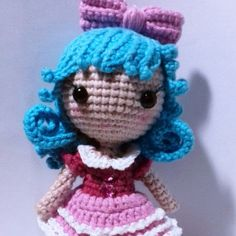 Use this free amigurumi pattern to create a tiny crochet doll with beautiful blue hair and cute clothes.