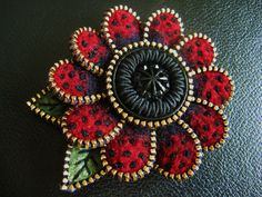 I can't help myself, the plain red petal tips were begging for a few French knots...