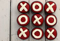 An easy Valentine Treat!  There is no link to a recipe as the photo was uploaded by user but they look like red velvet cupcakes simply iced with (probably cream cheese icing) in X's and O's!