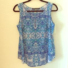 Fun Spring Blouse Beautiful patterned blouse in like new condition. Will be so fun for spring! Rose & Olive Tops Tank Tops