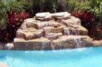 Waterfalls can come in a variety of different materials and styles in #swimmingpools. Call Swimming Pools By Ike at 954-346-4100 to see which one compliments your backyard!