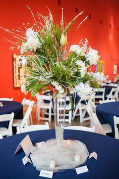 Wedding reception. Tall white flower arrangements.