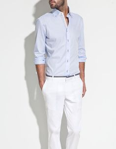 Light blue, beautiful spun cotton shirt with nice finishing. White chinos and narrow, belt look stripe complete the look