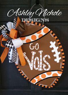 Tennessee Inspired Football Door Hanger, Door Decoration, Fall Wreath, Wooden Football by DesignsAshleyNichole on Etsy https://www.etsy.com/listing/198133014/tennessee-inspired-football-door-hanger