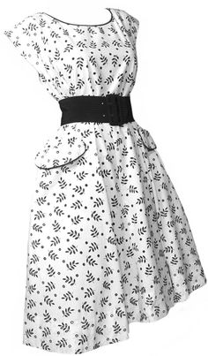 1950s Sundress in a fabulous black and white cotton with punched polka dots. Each dot is a little hole with an embroidered edge - you could spice up the dress by wearing a bright colored slip underneath. Black piping at the neckline and on the pockets. Capped sleeves. Fit and Flare construction with side zipper. We've photographed with a wide black satin belt - not included. Excellent condition.