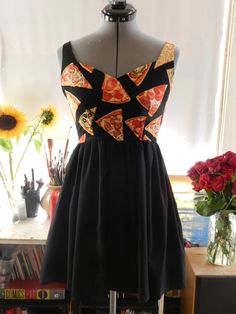 *gasp* I think we found our new event uniform. Pizza Party Backless Sundress. $67.00, via Etsy.