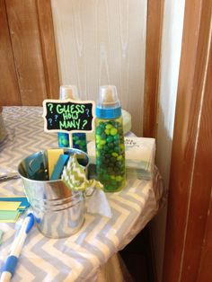 Guess how many baby shower game. Get different bottles filled with different items. More than one winner.