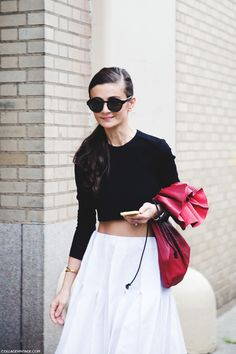 Natalia Alaverdian in white midi skirt & black crop top