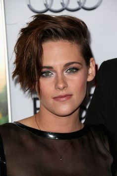 Kristen Stewart Metallic Eyeshadow Kristen Stewart carried her edgy look over to her makeup with silver-rimmed eyes at the AFI FEST 2014 screening of 'Still Alice.'