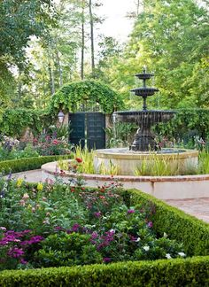 The Houston, Texas home of Glenn and Judy Smith is surrounded by beautiful gardens.  This French Colonial home, designed by architect Ken Tate, sits in the Woodlands suburb in Houston.  The beautiful garden was designed by landscape architect Helen Grivich.