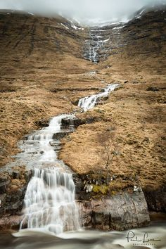 Glen Etive waterfall down the side of Criese, Scotland's Highlands.