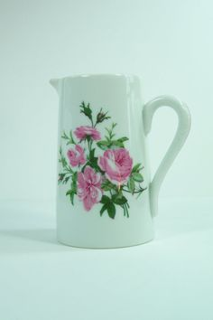Pitcher for dessert or coulis white porcelain with pink roses.  Height : 5.1 Mouth diameter : 2.6 Base diameter : 3.1 Length : 4.7 Weight : 0.65 lb  Vintage items in my shop are not new, they already have been used, sometimes for several years. So you can see marks of use, this is patina and that 's making the interest of the item. You can visit my shop here to find other items : www.etsy.com/fr/shop/MyFrenchIdeedAntique You can also visit my other Etsy shop full of vintage jew...