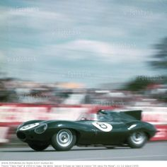 The Le Mans 24 Hours; Le Mans, June 11-12, 1955. The Jaguar D-type of Don Beauman and Norman Dewis in Dunlop Curve. Their car eventually went off the road and had to retire. (Photo by Klemantaski Collection/Getty Images)