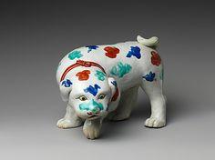Dog Period: Edo period (1615–1868) Date: late 17th century Culture: Japan Medium: Porcelain with overglaze enamels (Hizen ware, Kakiemon type) Dimensions: H. 6 1/4 in. (15.9 cm); W. 6 1/4 in. (15.9 cm); L. 8 7/8 in. (22.5 cm) Classification: Ceramic
