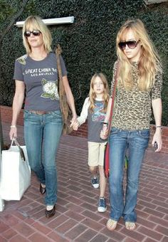 2006: Young Dakota Johnson stepped out with her mom and lil' sis Stella in this laid-back animal print top and jeans. http://thestir.cafemom.com/beauty_style/186557/dakota_johnsons_changing_looks_from