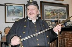 Ed Zamorski holds a sword dated from 1861 that was presented to him from descendants of the original owner. Zamorski, a Civil War re-enactor with the rank of Major, is one of the senior military staff directing the entire event of the 150th anniversary of the Battle of Gettysburg.