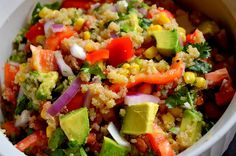 quinoa, black beans, avocado, tomatoes, red onion, red pepper, cilantro and for the dressing all I do is squeeze lime juice on top.