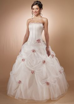 Love the pink rose on this wedding dress