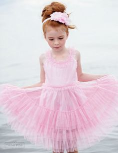This cute flower girl dress features many layers of soft pink ruffly tiers of tulle, adding a fun texture. The waistband and straps are ruffled to tie it all together. While this is perfect for the beach, it's also perfect for any other occasion from church to weddings to play. SHOP little girls clothing at http://thinkpinkbows.com/products/tropical-fantasy-pink-tulle-dress | Girls Dresses | Kids Vintage Fashion
