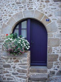 blue door and stonework