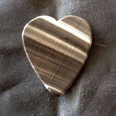 SEASHELL GUITAR PICK- 1.8mm thick. Heart shape. Made from actual sea shell. by BeachSidePicks on Etsy #guitarpicks