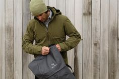 Men's Ames Jacket by Arc'teryx: Refined Coreloft™ insulated GORE-TEX® jacket for cool, wet urban environments.  Granville Backpack by Arc'teryx: The 20 litre Granville offers speedy access to digital tools while being sophisticated and urban in its design.