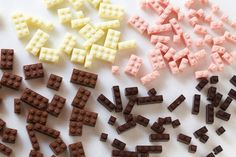 These are the edible chocolate LEGO blocks created by Akihiro Mizuuchi. They're made by pouring liquid chocolate into LEGO brick shaped molds and waiting for it to cool. Afterwards, they're durable enough to build with, provided. Chocolate Lego, Melting Chocolate, White Chocolate, Chocolate Molds, Chocolates, Food Porn, Lego Brick, Marzipan, Food Design