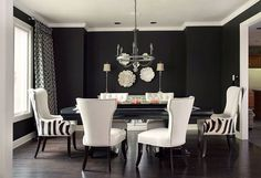 dramatic black white and grey dining room decor with striped chairs and large dining table