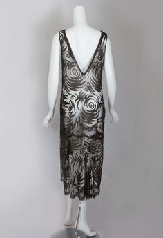 96ba5a247e6 Silk lace flapper dress with deep V-necklines in front and back.