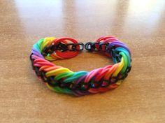 Rainbow loom triple link bracelet. http://m.youtube.com/watch?v=03YxdptzOcs&desktop_uri=%2Fwatch%3Fv%3D03YxdptzOcs