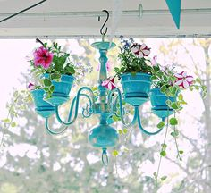 Spruce up your garden with these cheap and easy DIY garden ideas. From DIY planters to container gardening ideas, there are plenty of garden projects on a budget to choose from. Chandelier Planter, Old Chandelier, Chandelier Makeover, Flower Chandelier, Chandelier Ideas, Chandeliers, Outdoor Chandelier, Turquoise Chandelier, Painted Chandelier